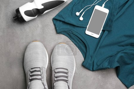 Composition with stylish men's shoes on grey background