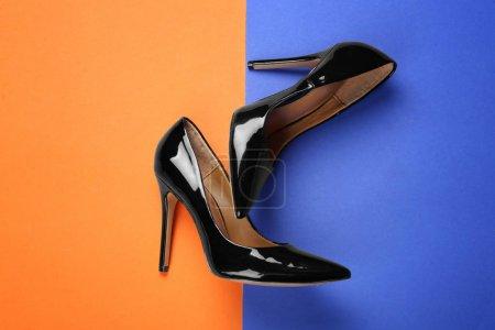 Photo for Elegant female shoes on color background - Royalty Free Image