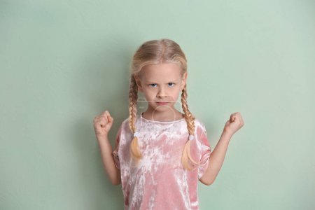Photo for Portrait of emotional little girl on color background - Royalty Free Image