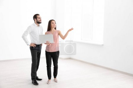Real estate agent showing apartment to client