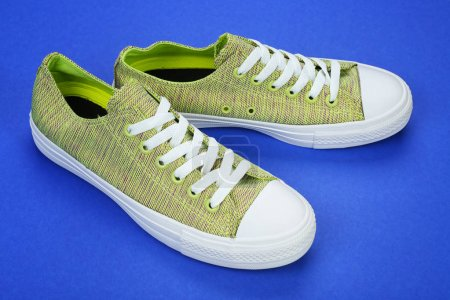 Casual female shoes on color background