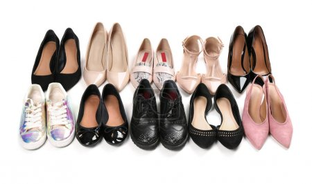 Various female stylish shoes on white background
