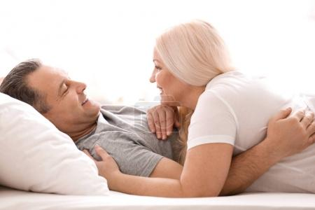 Photo for Senior couple in bed together at home - Royalty Free Image