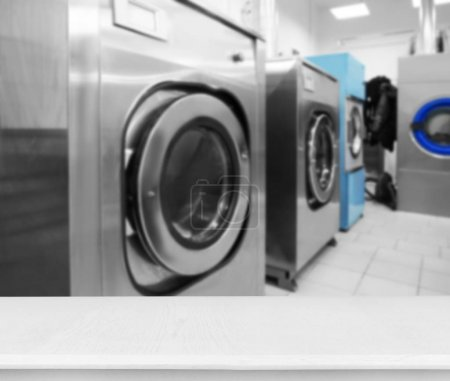 Table and washing machines at self-service laundry