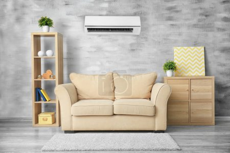 Living room interior with comfortable sofa and air conditioner