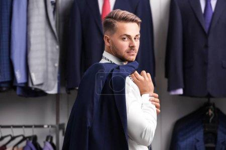 Handsome man in suit store