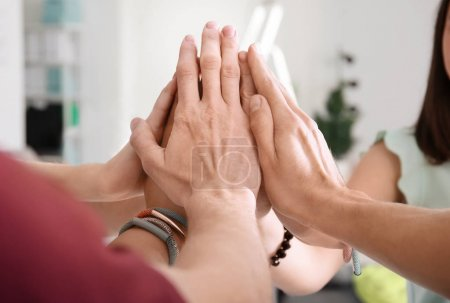 People putting hands together