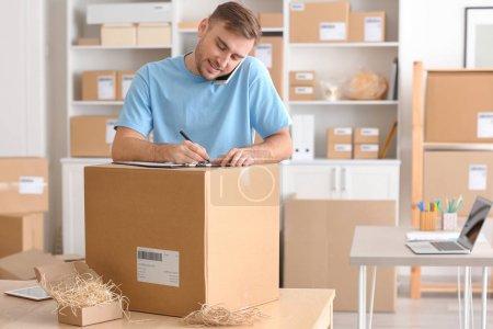 Young man preparing parcels