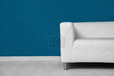 Photo for Comfortable sofa against color wall - Royalty Free Image