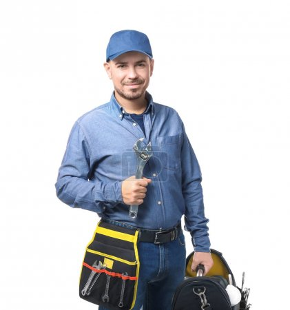 Plumber with set of tools on white background