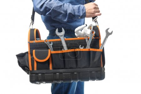 Plumber with tool bag on white background, closeup