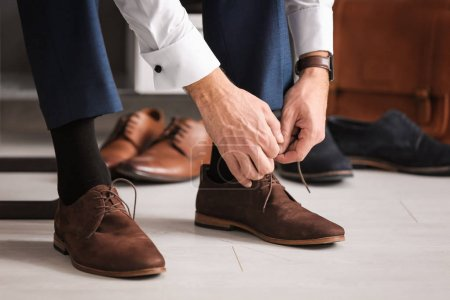 Photo for Man trying on new shoes indoors, closeup - Royalty Free Image