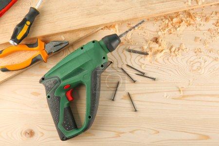 Carpenter's equipment on wooden table in workshop