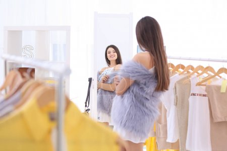 Young  woman shopping in store