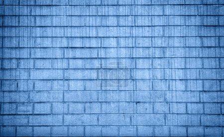 Foto de Grunge la textura de la pared de ladrillo, copia el espacio. Fondos azules clásicos. Color del año 2020. Vista superior, lecho plano - Imagen libre de derechos