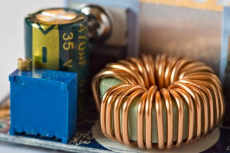 Photo for Toroidal inductance coil on circuit board - Royalty Free Image