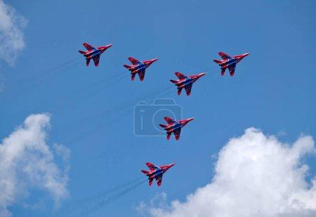 Russian aerobatic display team Swifts in Arrow formation