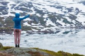 Tourist woman enjoying mountains landscape in Norway
