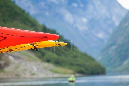 Many canoes on norwegian fjord shore