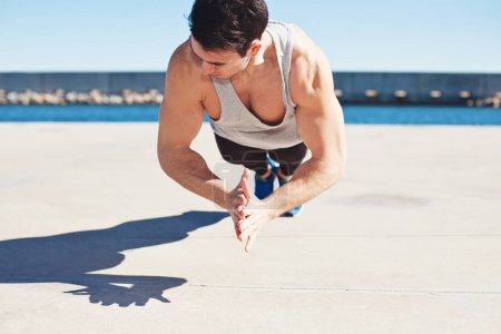 young athletic man doing sport exercise outdoors
