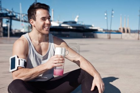 Handsome athlete with protein cocktail