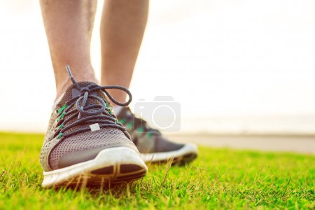 Sportsman's legs in running shoes close up