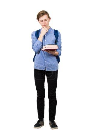 Photo pour Étudiant réfléchi gars portrait pleine longueur tenant des manuels regardant perplexe, main sous le menton, isolé sur fond blanc. adolescent garçon préparé pour examens, pensée de ides et planification . - image libre de droit