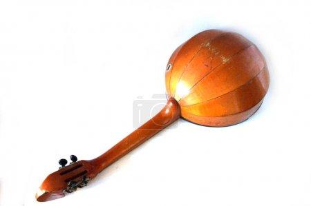 Folk musical instrument domra on wooden background  Stock Image