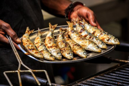 Freshly grilled sardines on silver plate