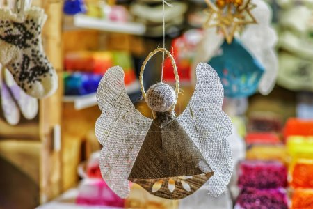 Handmade linen angel hanging at the Riga Christmas market stall