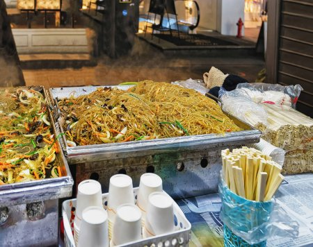 Noodles at Myeongdong open street market in Seoul Asia