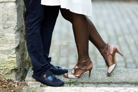 Couple hugging at street