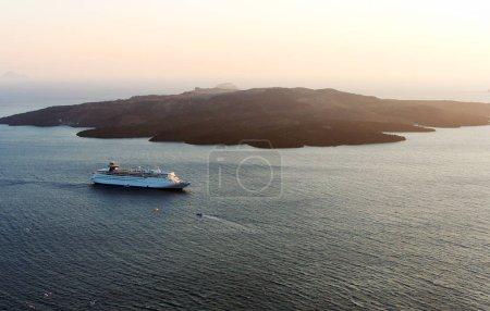Cruise liner floating near island
