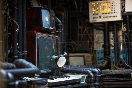 electronics in dark room with pipes
