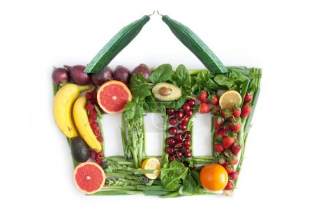 Photo for Fruits and vegetables in the shape of a grocery basket - Royalty Free Image