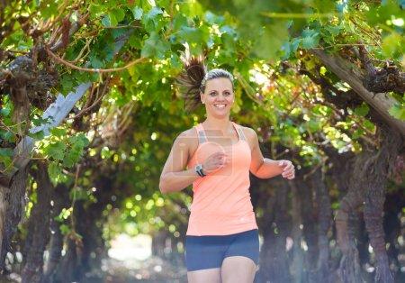 Female triathlete running on a trail