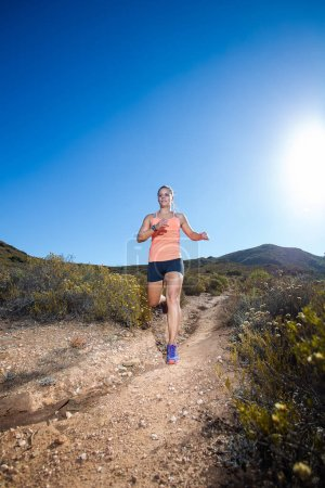 Female triathlete running on a trail