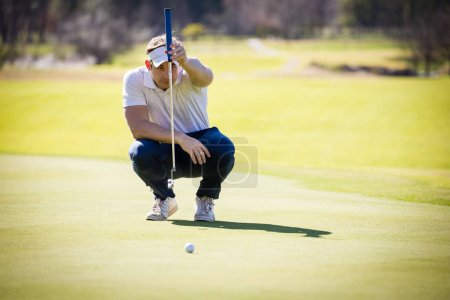 golfer planning his shot to the pin