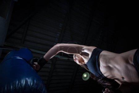 Female boxer punching a punching
