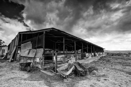 Wide angle view of old buildings and farm instrume...