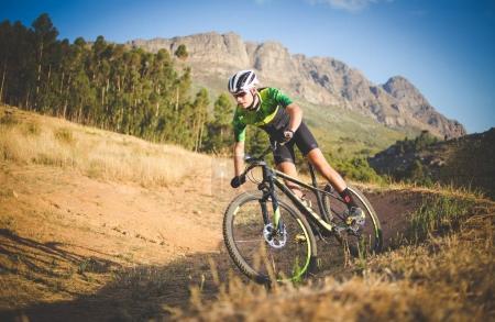 mountain biker speeding downhill