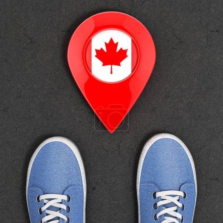 Photo pour Voyage au Canada Concept. Baskets en denim bleu sur la route asphaltée avec pointeur de carte et drapeau du Canada Voir de plus près. Rendu 3d - image libre de droit