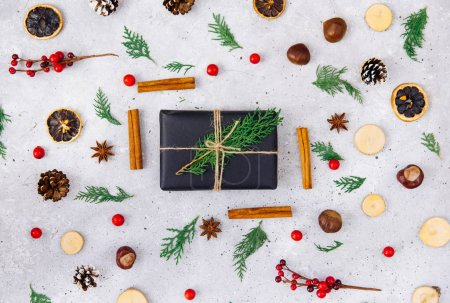 Christmas holiday composition with natural decorations and gift box. Winter concept. Flat lay, top view. Copy space.
