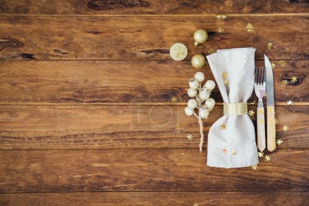 Christmas and New year table place setting over wooden background. Copy space