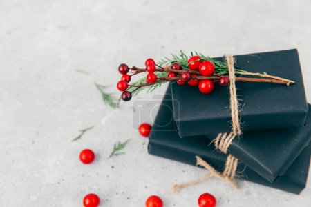 Cozy vintage toned winter holidays Christmas Composition with Gifts Boxes. Styled photography for blog posts. Flat lay top view.