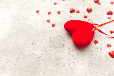 Valentine day. Red heart pendant on a background. Valentine's Day. Heart pendant. Space for text. Eighth of March. International Women's Day.