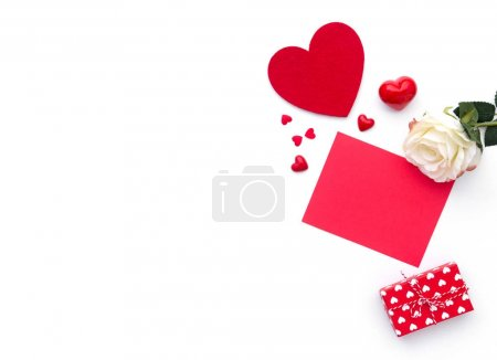 Background Valentine's Day. Gift box, rose and hearts isolated on white