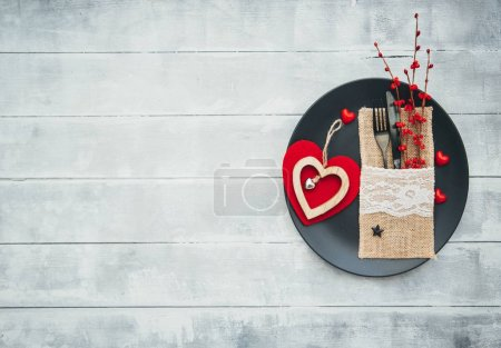 Romantic dinner concept. Festive table setting for Valentines Day on wooden background.