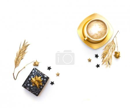 Flat lay with coffee and gift box. White background