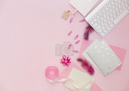 Flat lay, luxury feminine desk workspace on pink background.
